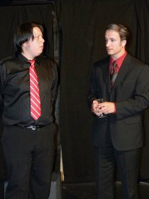 Kevin Scofield (left) as Hamlet and Sam Logan (right) as Claudius